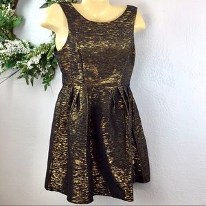 She & Sky black and gold cocktail dress, back bow